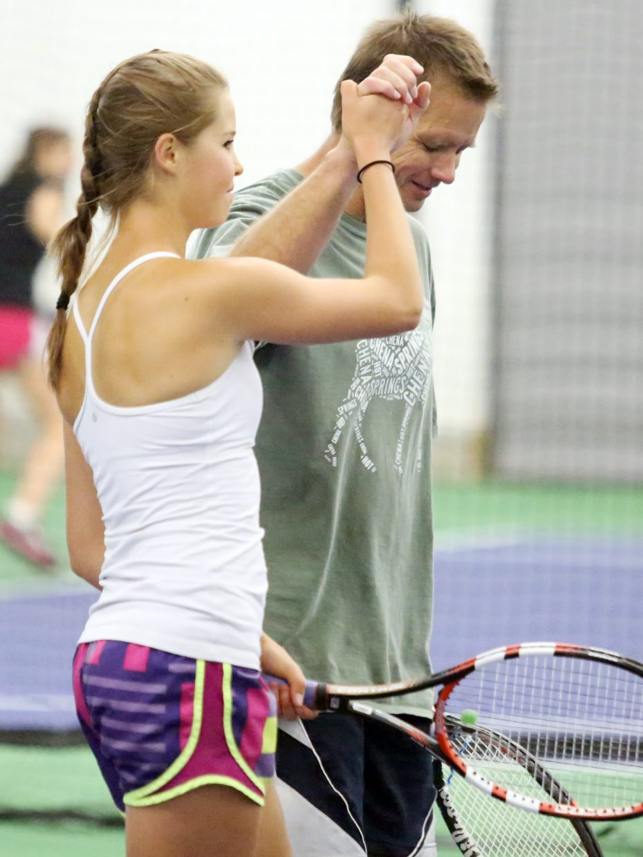 Steamboat's Kira Lorenzen, left, is congratulated by her father and doubles partner, Dave Lorenzen, following their final match Sunday at The Tennis Center at Steamboat Springs. The pair went 2-0 over the weekend to win the Combined Mixed 9.0 Doubles round robin of the 2015 Steamboat Tennis Association Summer Championships.