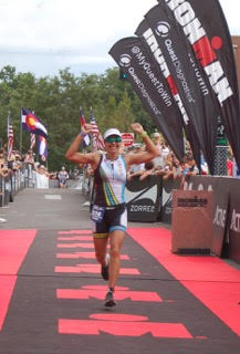 Steamboat Springs resident Heather Gollnick crosses the finish line of Sunday's Ironman Boulder. Gollnick, 45, won her age division and finished third overall among all women. It was the 37th career Ironman Gollnick had completed.