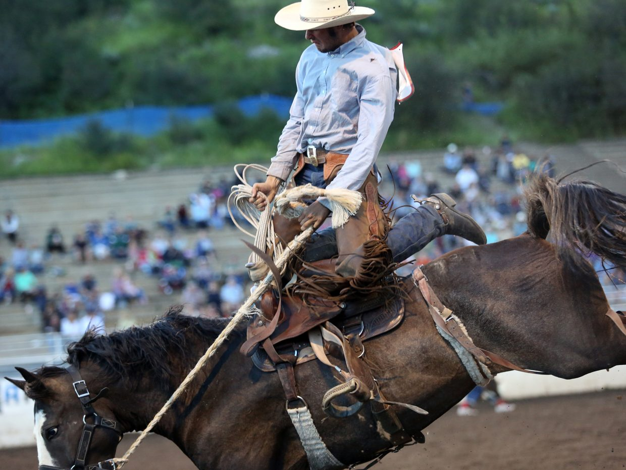 A ranch bronc rider competes in Saturday's Steamboat Springs Pro Rodeo Series event at Brent Romick Arena. It was the eighth week of the summer series. Only two weeks remain on the schedule.