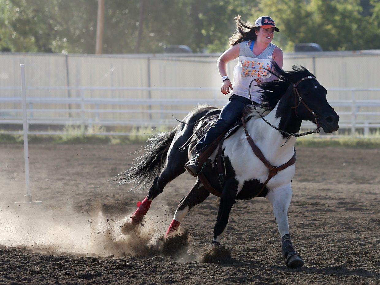 Steamboat Springs resident Arielle Gold, best known for being a professional snowboarder, competes in the gymkhana competition on Sunday as part of the 101st annual Routt County Fair at the fairgrounds in Hayden. The opening weekend of the fair was highlighted by the Open Horse Show competitions and will continue through Sunday.