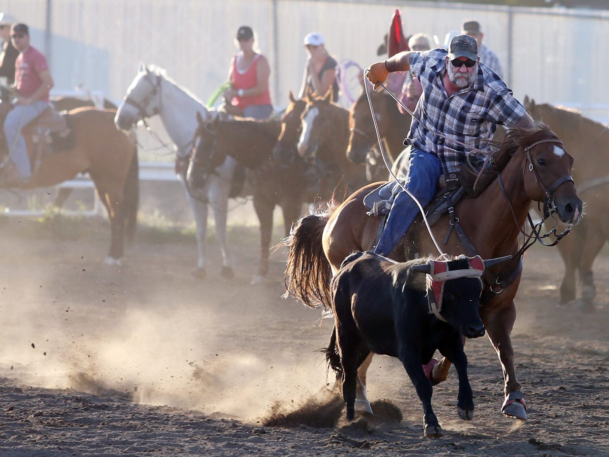 Craig's Jim McCoy competes in Sunday's jackpot roping competition as part of the 101st annual Routt County Fair at the fairgrounds in Hayden.