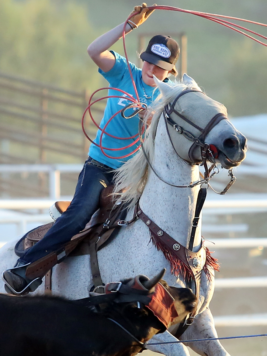 Yampa's Katie Parker, 19, competes in the jackpot roping competition on Sunday as part of the 101st annual Routt County Fair at the fairgrounds in Hayden. The opening weekend of the fair was highlighted by the Open Horse Show competitions and will continue through Sunday.