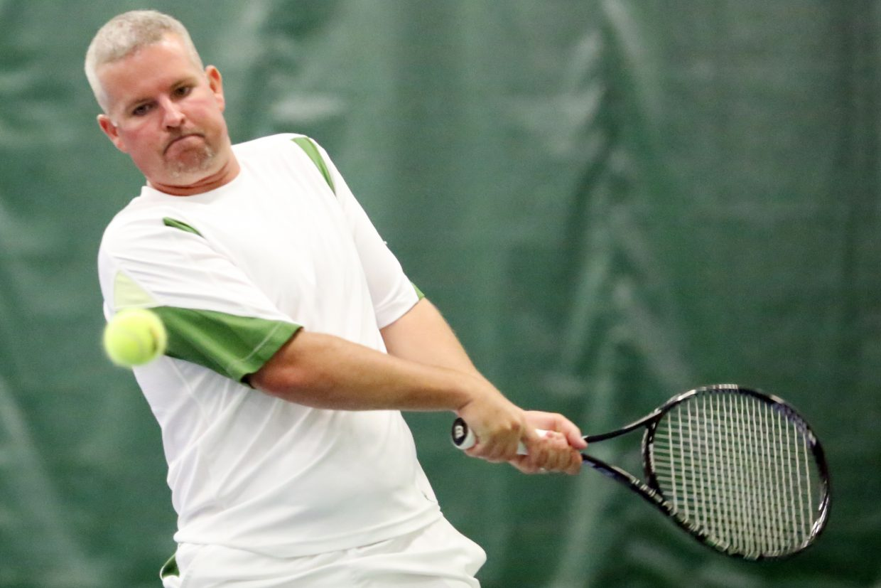 Parker's Adam Paschal competes in Sunday's men's 4.5 doubles championship inside The Tennis Center at Steamboat Springs.