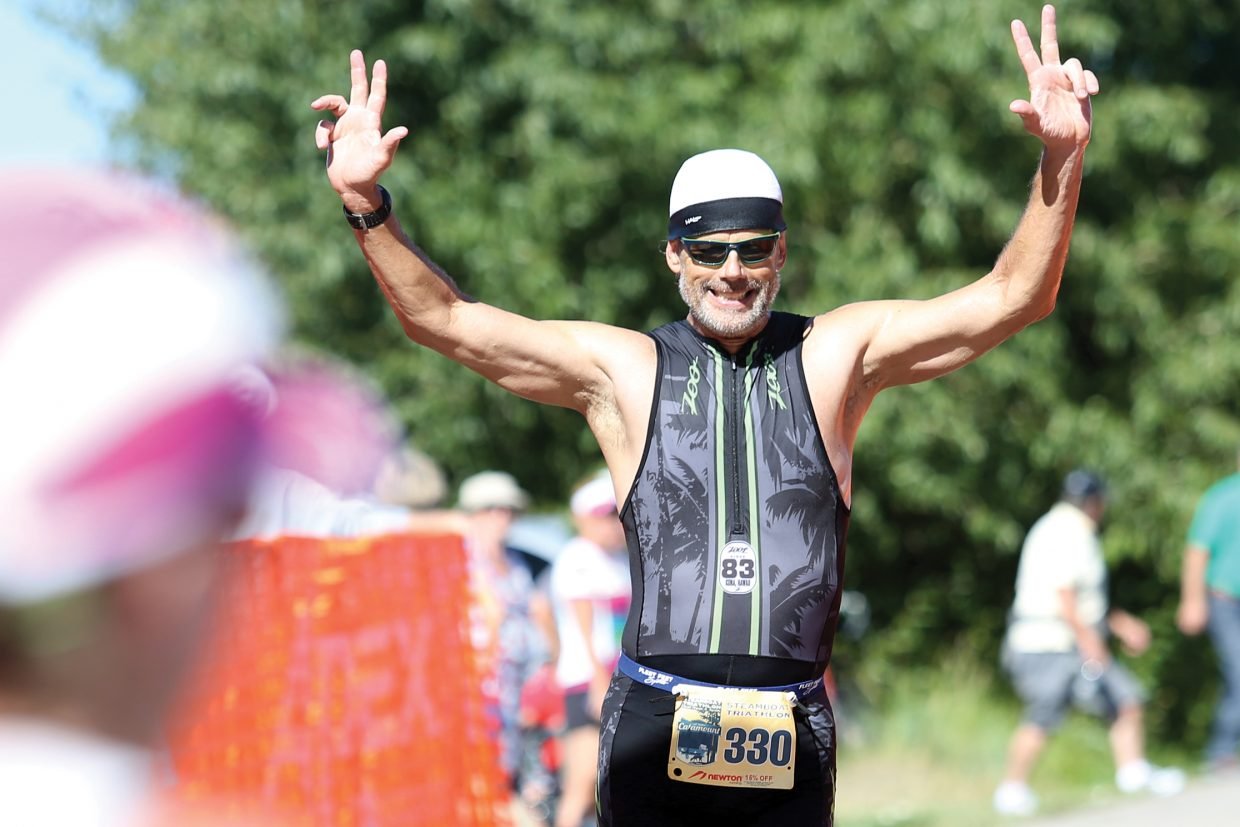 Longmont's Chris Westman competes in the 2015 Steamboat Triathlon at Lake Catamount. More than 300 competitors are expected to take part in the event through the weekend.