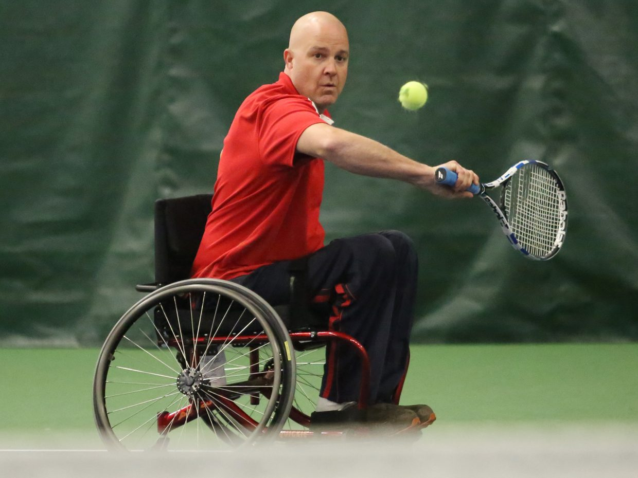 Craig Kennedy, client services and outreach director for STARS, works on his backhand Thursday during the Wheelworks Wheelchair Tennis Training session inside The Tennis Center at Steamboat Springs.