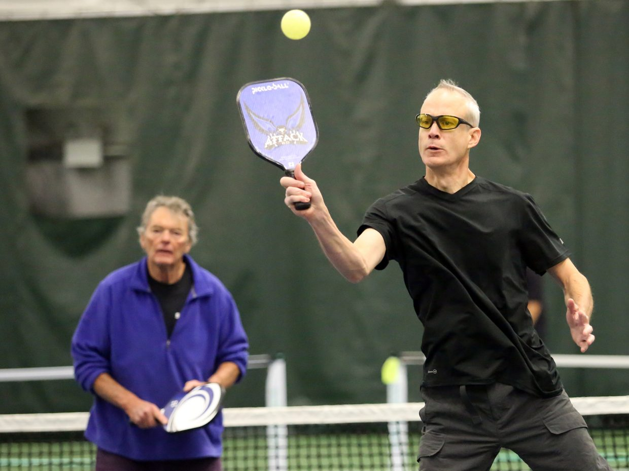 Brad Stiff, right, alongside doubles partner Phil Street, plays a friendly game of pickleball on Sunday inside The Tennis Center at Steamboat Springs.