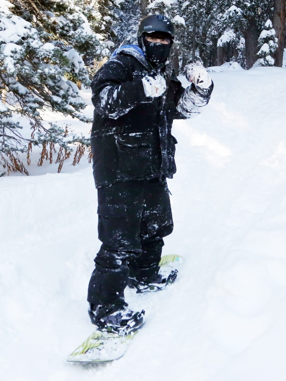 Steamboat Today reporter Austin Colbert gives two thumbs up through his mittens while riding a snowboard on Rabbit Ears Pass earlier this week.