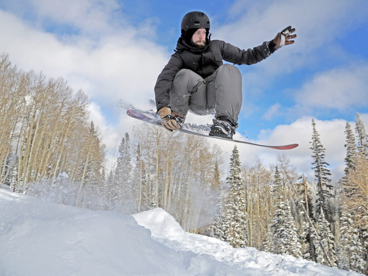 Steamboat's Devin Patrick Lightheart gets air off a jump Thursday on Rabbit Ears Pass. Lightheart is roommates with Steamboat Today reporter Austin Colbert, who snowboarded for the first time this week.