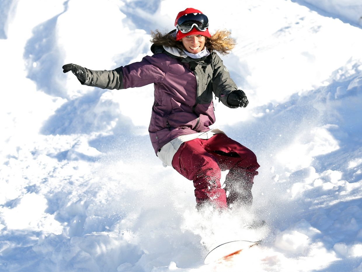 Steamboat Springs resident Penelope Freedman snowboards on Rabbit Ears Pass on Friday. Freedman, an experienced snowboarder, was one of a handful who joined photographer Austin Colbert on the trip. Colbert snowboarded for the first time this week.