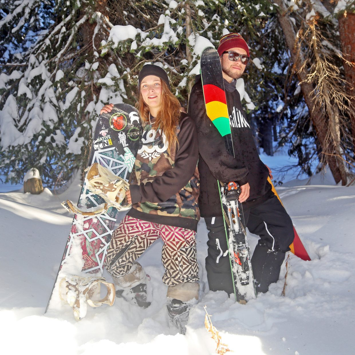 Steamboat Springs residents Kristina Edwards, left, an avid snowboarder, and skier Brian Erhart have different approaches when it comes to getting down the mountain. But it's their passion for the snow that is bringing the two sports together.