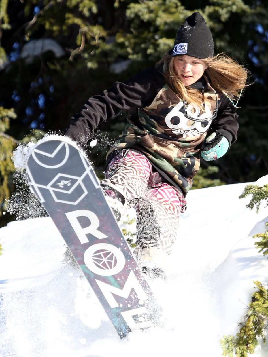 Steamboat's Kristina Edwards gets air during a snowboard session on Rabbit Ears Pass in mid-November.