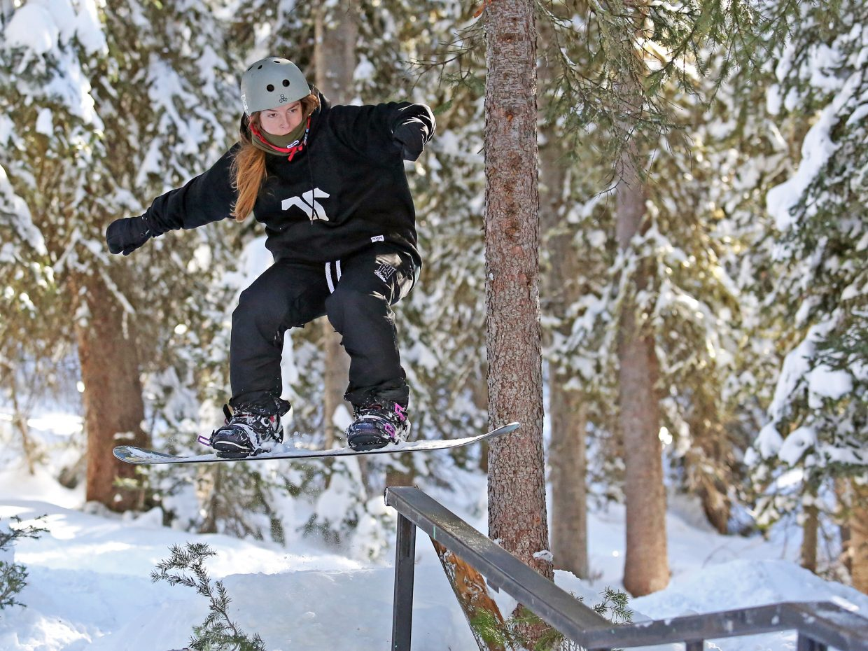 Steamboat Springs resident Lacey Slifer attempts to grind a rail on her snowboard over the weekend in Rabbit Ears Pass. More snow is expected this week, meaning plenty of fresh powder for the snowboarders and skiers.