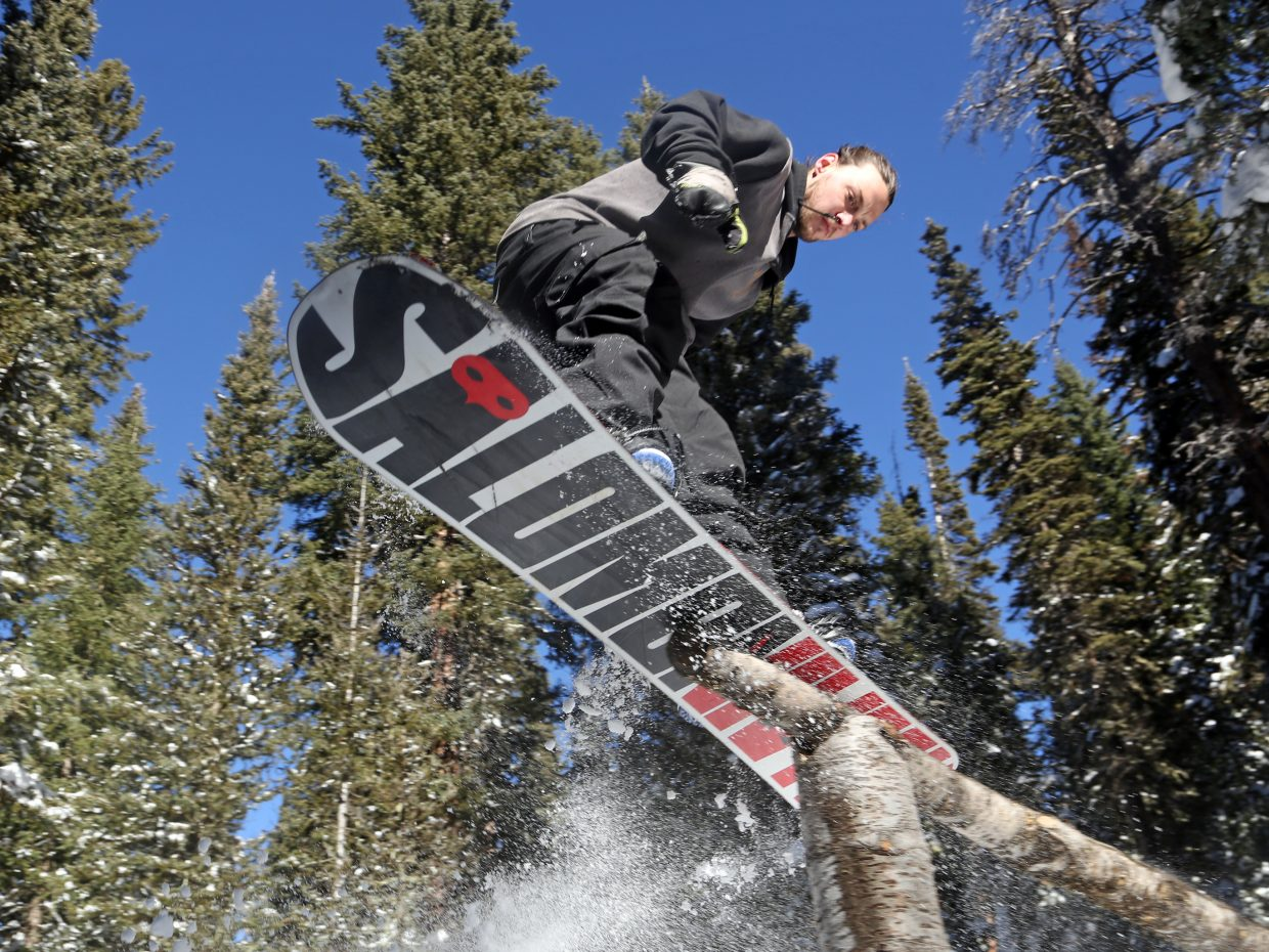 Steamboat's Tyler Ruffenach gets air off a custom rail made out of two logs on Rabbit Ears Pass in November.