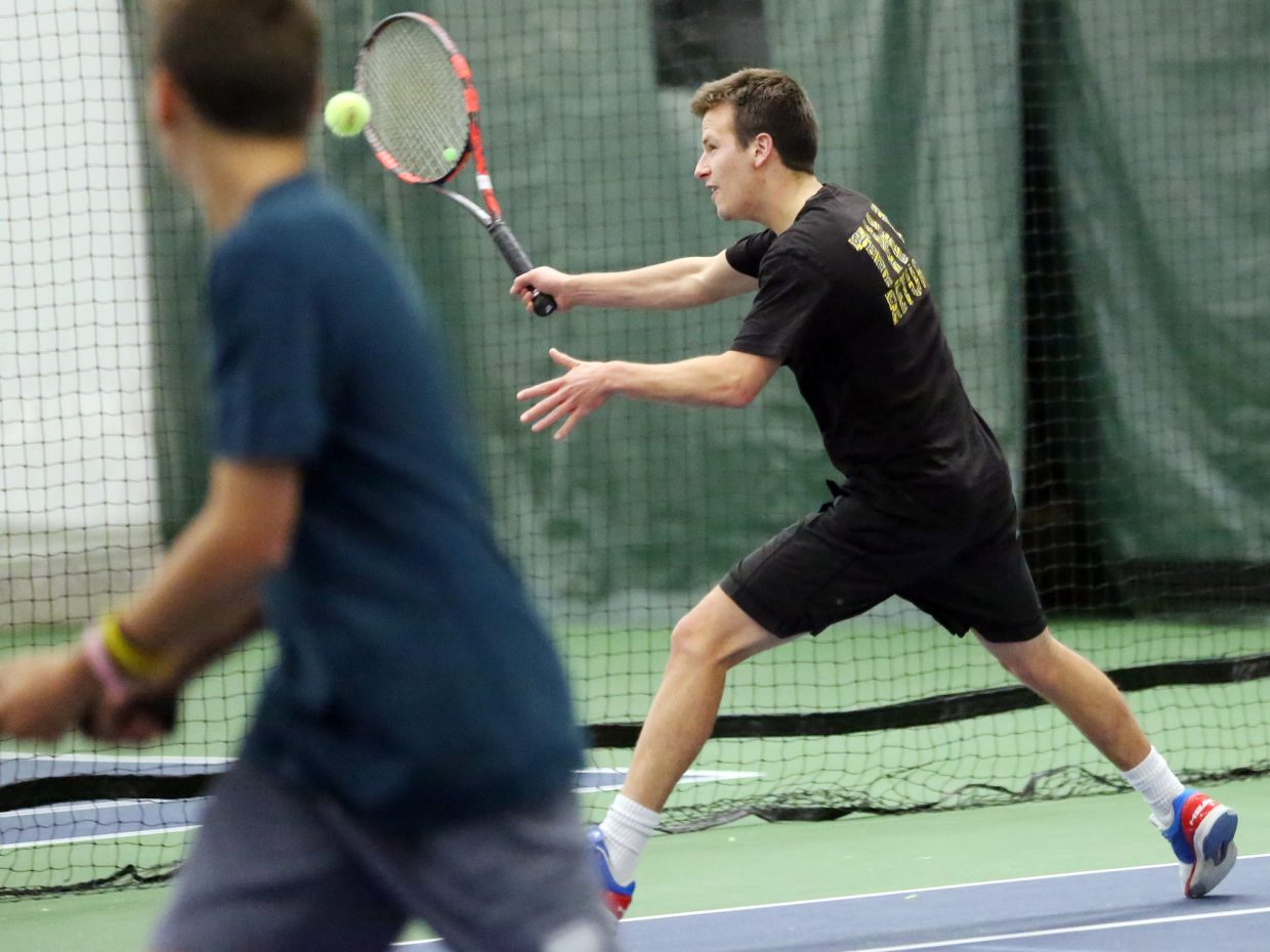 Jack Burger, right, alongside his brother Teague, competes in the 2015 Steamboat Springs City Tennis Championships on Sunday at The Tennis Center. Jack and Teague paired up to win the men's 4.5 doubles portion of the tournament.