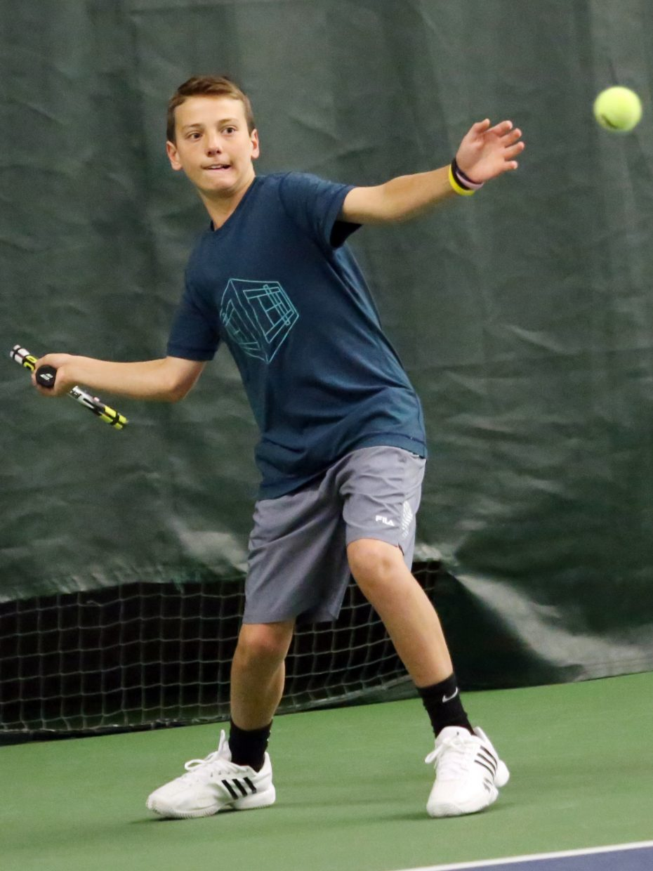 Teague Burger, a freshman at Steamboat Springs High School, competes in the 2015 Steamboat Springs City Tennis Championships on Sunday at The Tennis Center. Burger won the men's 4.5 singles flight as well as the men's 4.5 doubles flight alongside his brother, Jack.