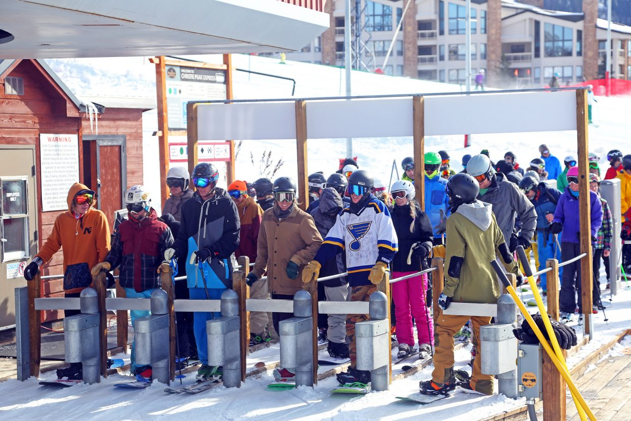 People wait in line for their turn to grab a seat on Christie Peak Express on Saturday at the Steamboat Ski Area.
