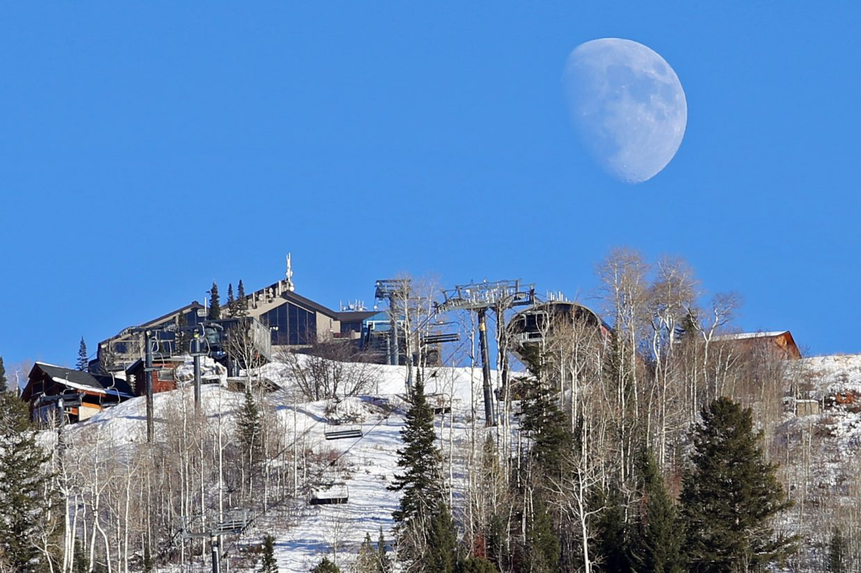 The moon rises over the Steamboat Ski Area late Saturday afternoon.