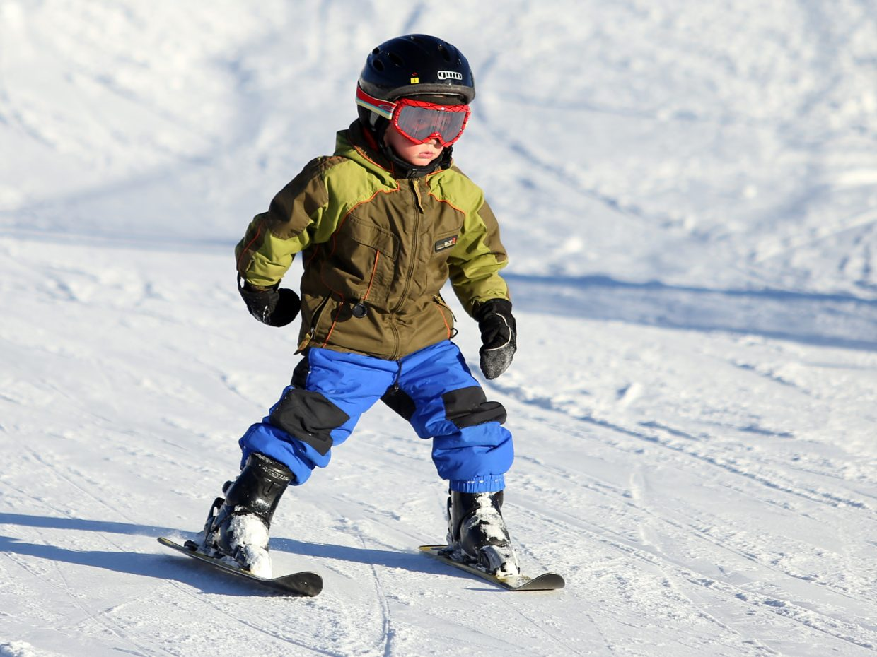 Steamboat Springs resident Oliver Nylen, 4, gets a run in Saturday at the Steamboat Ski Area.