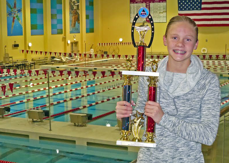 Steamboat Springs resident Jenna Smith, a member of the Steamboat swim team, poses with her trophy after she took second place overall in the girls' 11 to 12 age division of the CUDA Pentathlon in Thornton over the weekend.