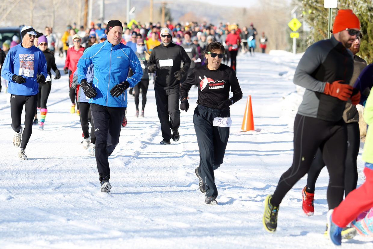 Runners take to the course Thursday near Steamboat Springs High School for the 2015 Turkey Trot, a fundraiser for the SSHS cross country and track and field teams.
