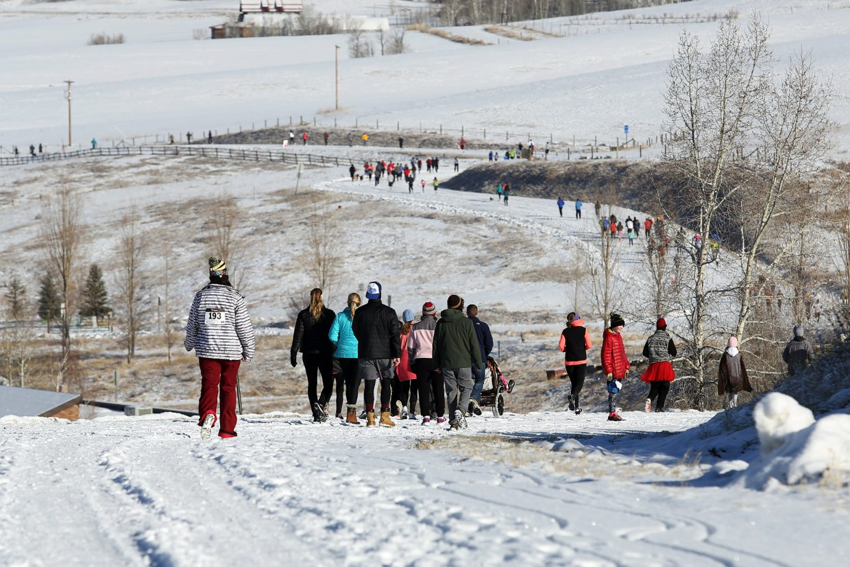 Runners make their way down a snowy Amethyst Drive on Thursday during the 2015 Turkey Trot in Steamboat Springs.