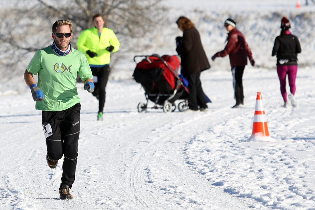 Erick Carlson, left, leads the pack during the 2015 Turkey Trot on Thursday in Steamboat Springs. Carlson, a part time Steamboat resident, won the 5K race in 19 minutes, 22 seconds.