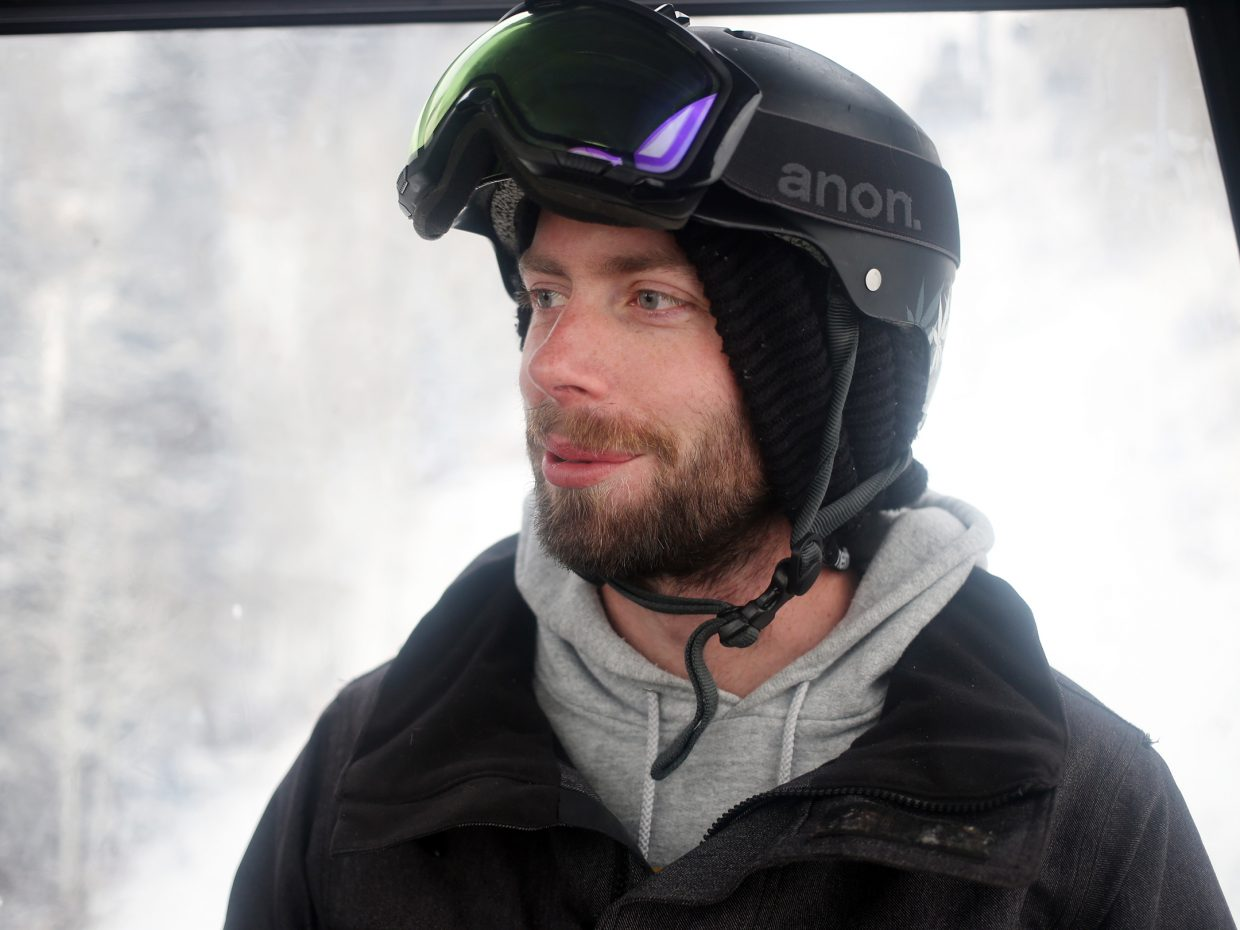 Devin Patrick Lightheart, roommate and gracious snowboarding instructor for the author, gets a ride up the gondola Friday afternoon.