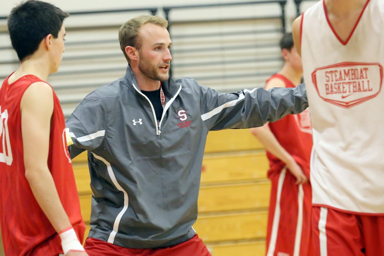 Steamboat Springs High School boys' basketball coach Michael Vandahl instructs players during practice Wednesday. Vandahl, a 2008 SSHS graduate, is in his first season leading the Sailors.