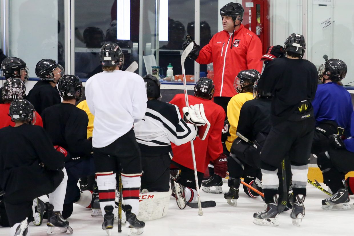 Steamboat Springs High School hockey coach Chris Campanelli talks to his players during a team practice Wednesday.