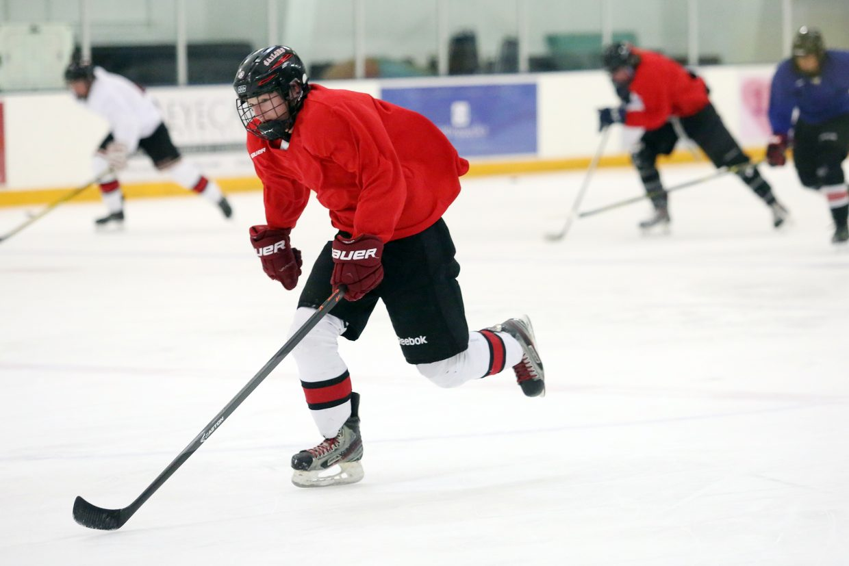 The Steamboat Springs High School hockey team runs through drills on Wednesday at the Howelsen Ice Arena. The Sailors, 1-0, will host Aspen Friday in their home opener.