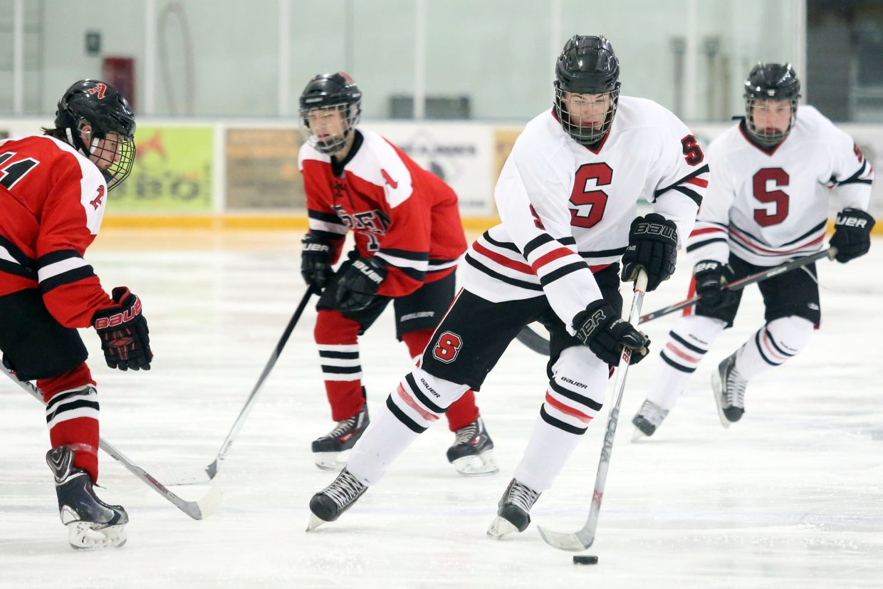 Steamboat Springs sophomore Nate Kelley leads an offensive attack in the third period against Aspen on Friday at the Howelsen Ice Arena. Kelley scored a goal in the Sailors' 5-2 win.