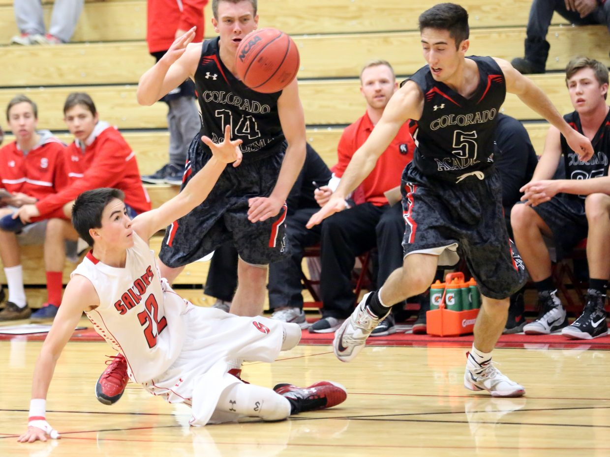 Steamboat Springs junior McKenyon King falls to the court during a scramble for a loose ball against Colorado Academy on Saturday in the final day of the Steamboat Shootout. Despite an impressive rally, the Sailors fell short in a 66-54 loss.