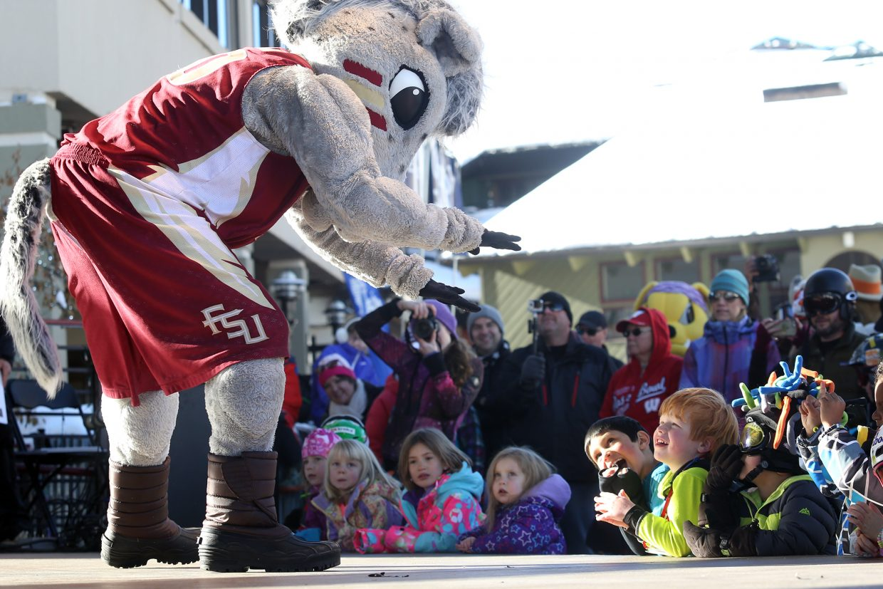 Cimarron, the mascot for Florida State University, delights children on Sunday at the base of the Steamboat Ski Area. Cimarron was one of nearly three dozen mascots from across the country taking part in the Steamboat Mascot Stampede over the weekend.