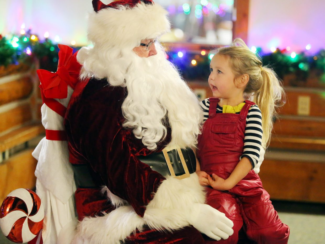 Steamboat's Zoe Finnegan, 4, meets with Santa on Sunday inside Olympian Hall, part of the Rotary Club's Holiday Tubing Party at Howelsen Hill. Zoe asked Santa for a pet unicorn.