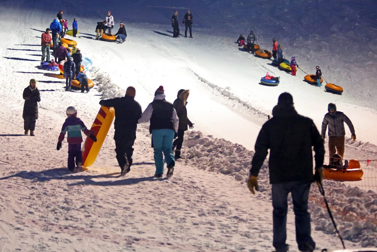 Tubers take to Howelsen Hill Sunday evening for the Rotary Club's Holiday Tubing Party.