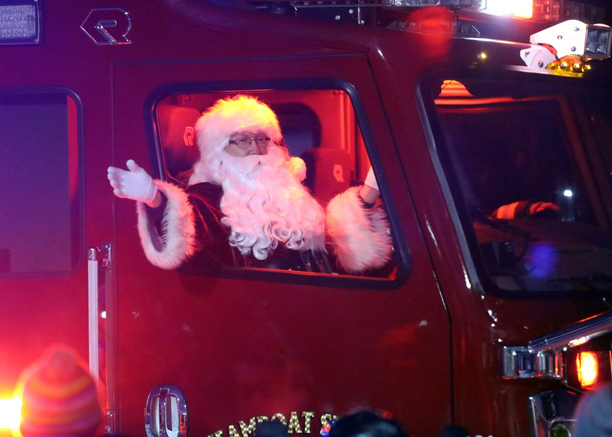 Santa arrives at Howelsen Hill Sunday via a fire truck, where he spent a few hours greeting children at the Rotary Club's Holiday Tubing Party.