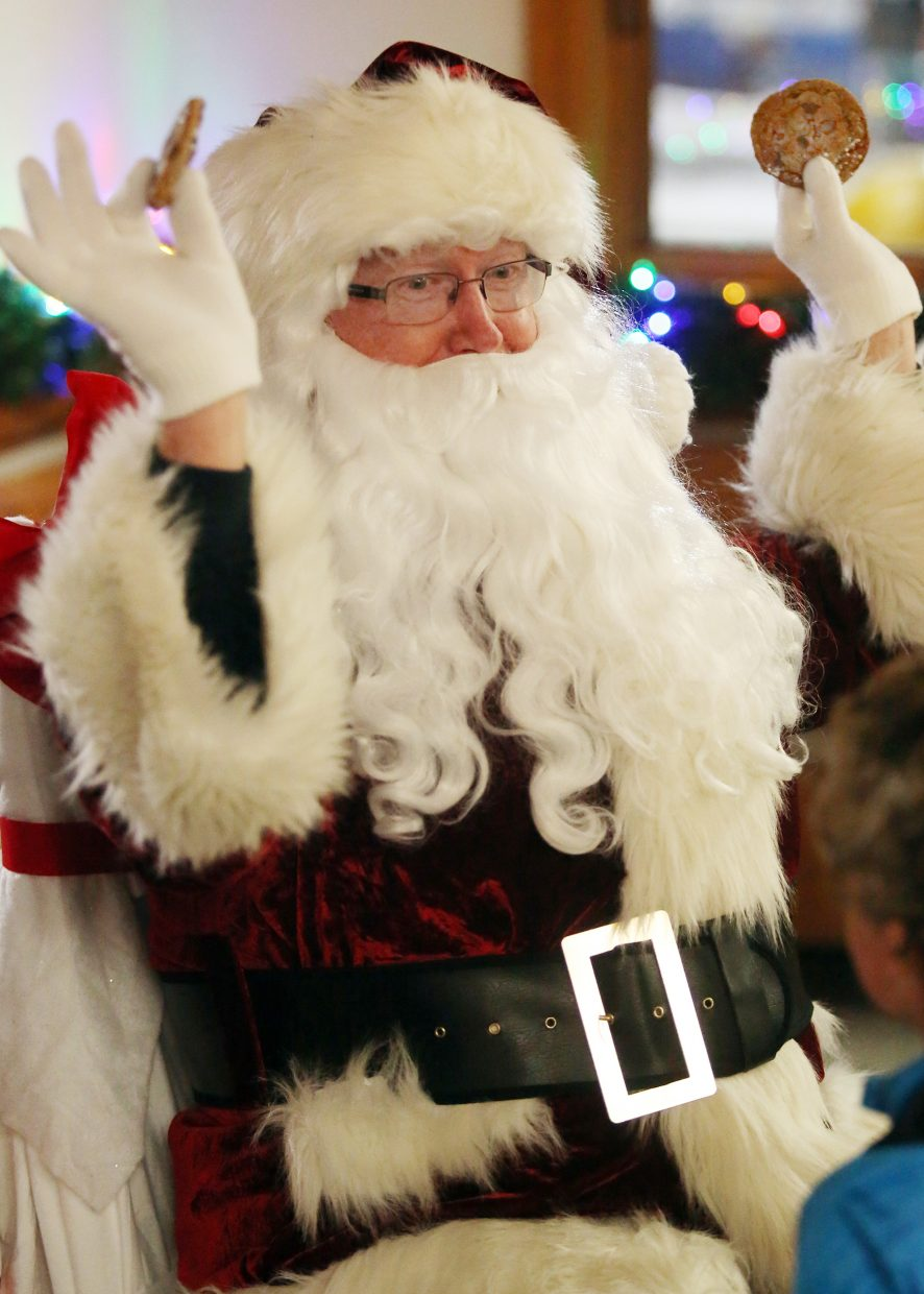 Santa was surprised with a couple of cookies, given to him by two young boys Sunday at the Rotary Club's Holiday Tubing Party at Howelsen Hill.