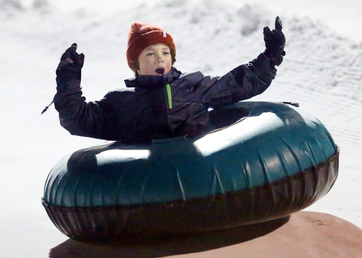 Reed Vanness, 7, tubes down a portion of Howelsen Hill on Sunday at the Rotary Club's Holiday Tubing Party.