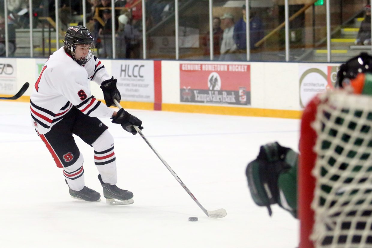 Steamboat Springs senior Scott Brown looks for a shot early in Friday's game against Summit at Howelsen Ice Arena. Brown finished with two goals in a 5-0 Sailors' victory.