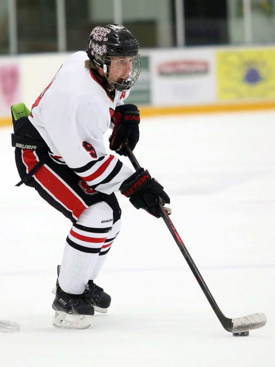 Steamboat Springs senior Jordan Gorr looks for an opening in the first period against Summit on Friday.
