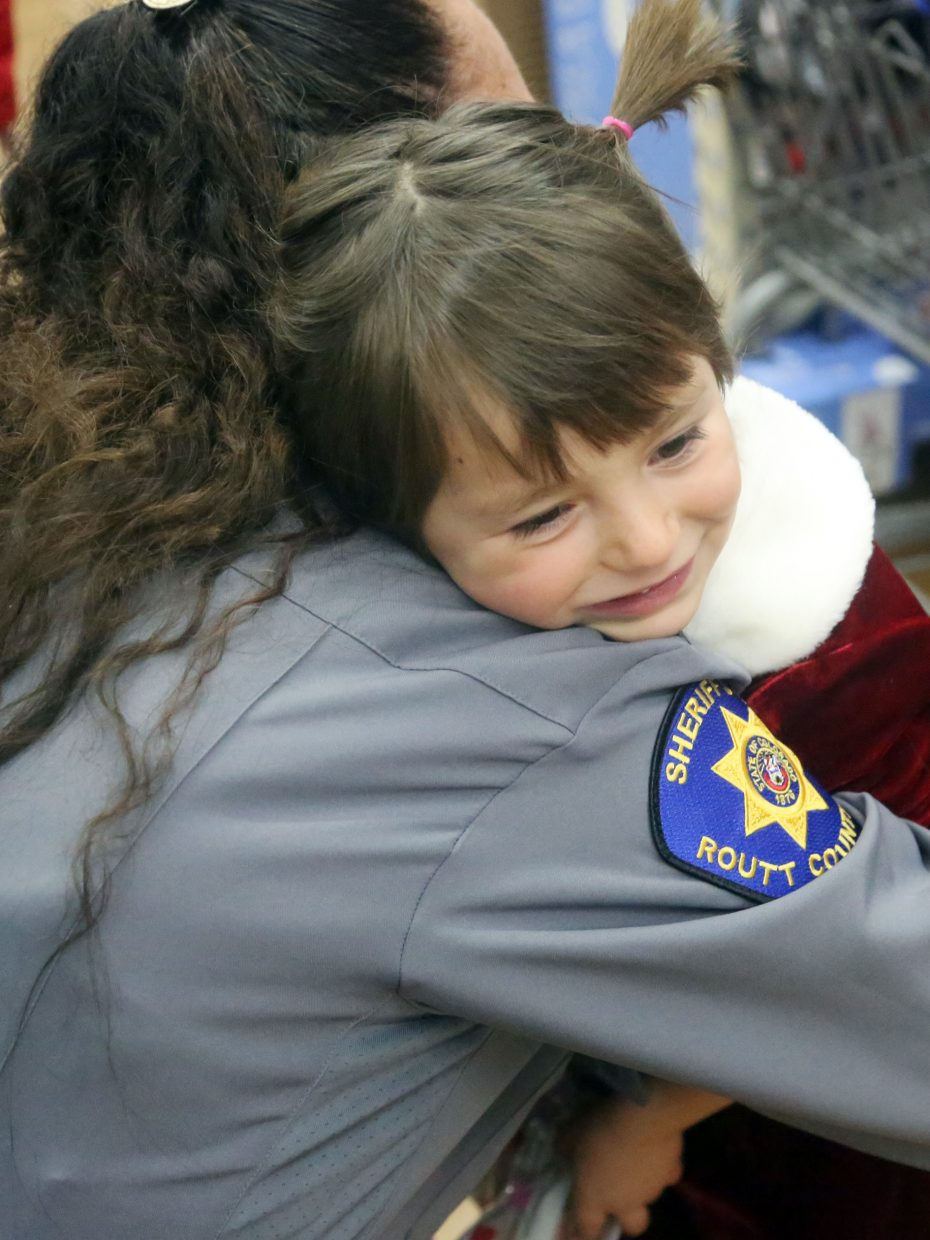 Hayden's Sophia Archuleta, 4, gives Lt. Michelle Richardson of the Routt County Sheriff's Department a hug on Sunday during their shopping trip at Walmart in Steamboat Springs.