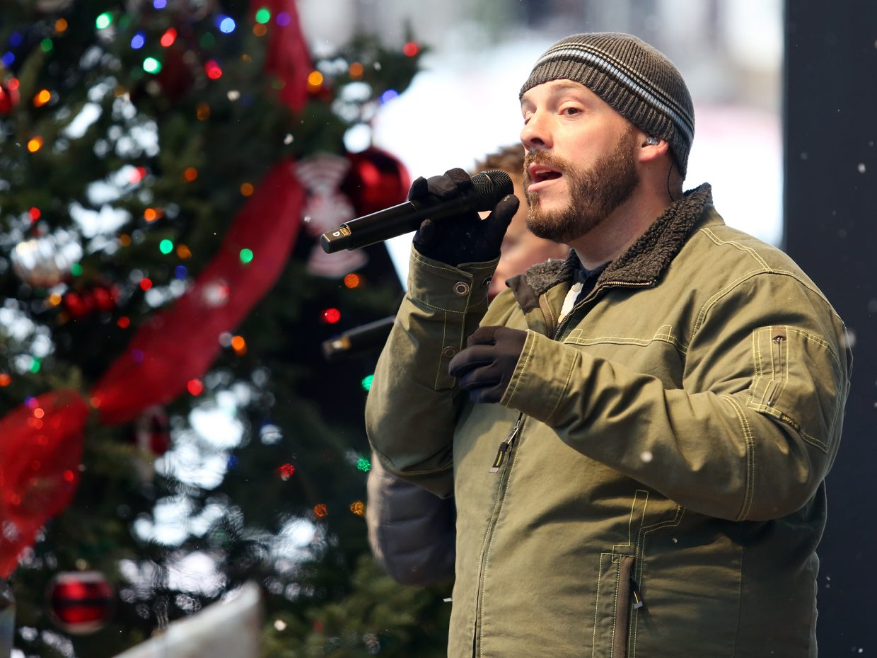 """Ryan Driver, of the Boulder-based vocal rock band """"Face,"""" sings on stage at the Steamboat Ski Area on Sunday during the holiday festival."""