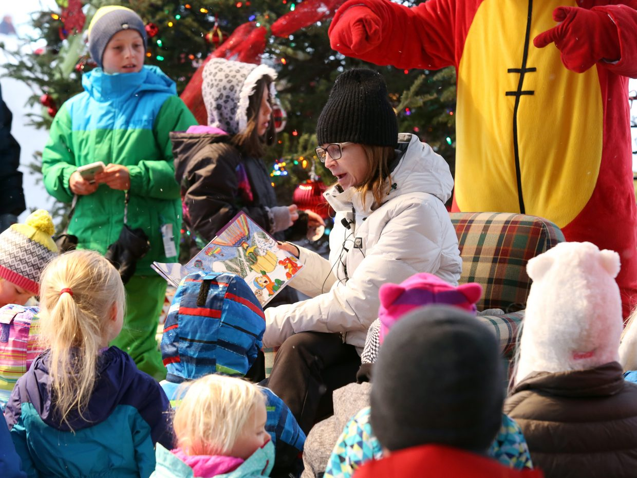 Elyssa Pallai, co-author of Eli and Mort's Epic Adventures Steamboat, reads the book to children during story time Sunday at the Steamboat Ski Area.