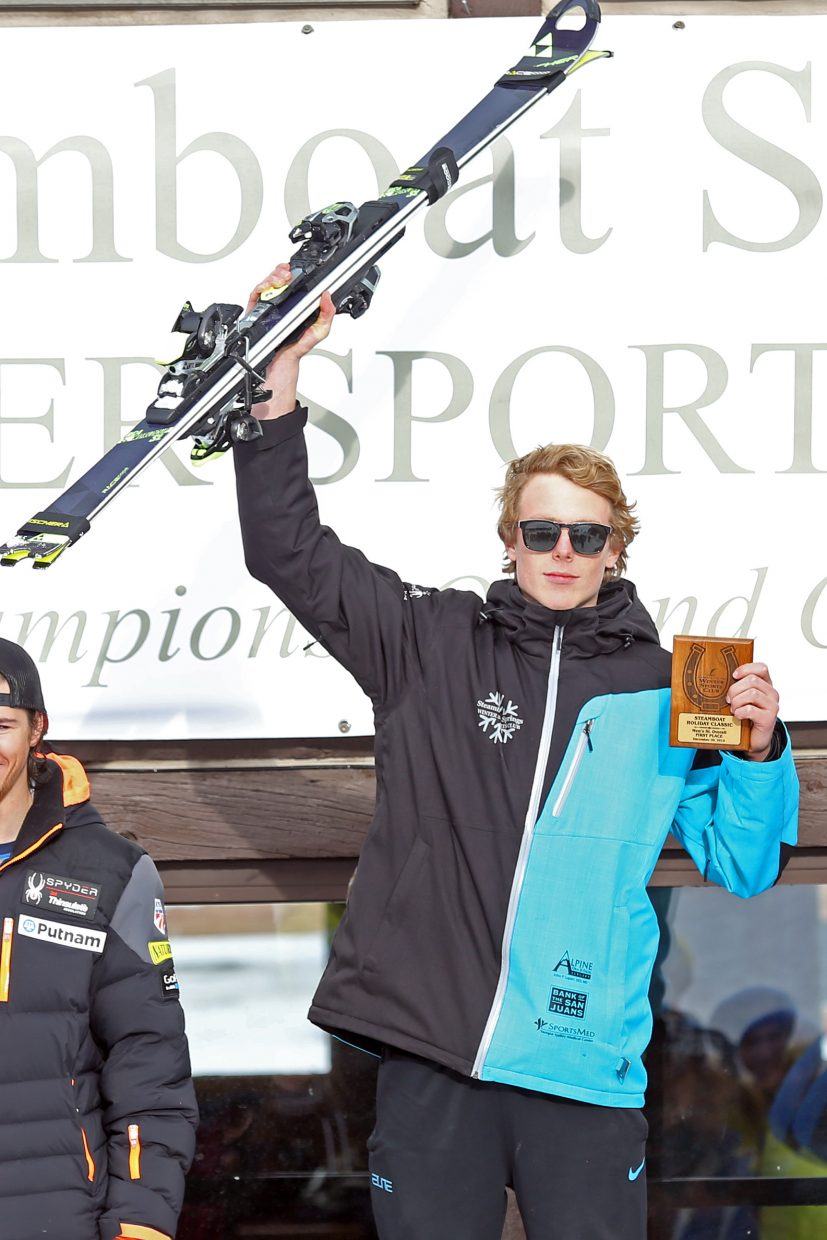 Steamboat Springs Winter Sports Club athlete Nick Santaniello celebrates on the podium after winning the men's portion of Sunday's National Junior Race slalom ski event at Howelsen Hill.