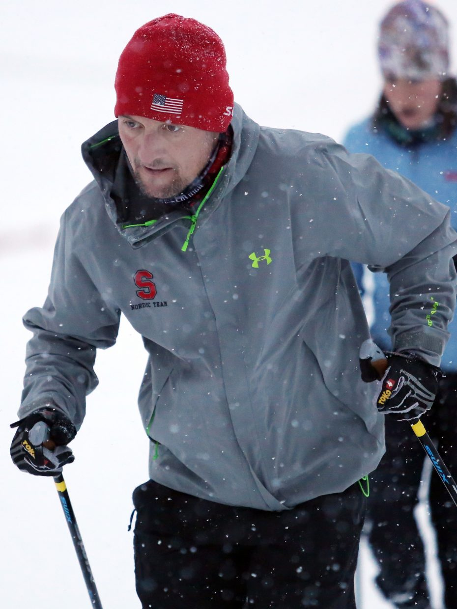 Steamboat Springs High School Nordic skiing coach Harry Niedl runs through drills with his team last week near the rodeo grounds downtown. Niedl is in his second winter leading the Sailors.