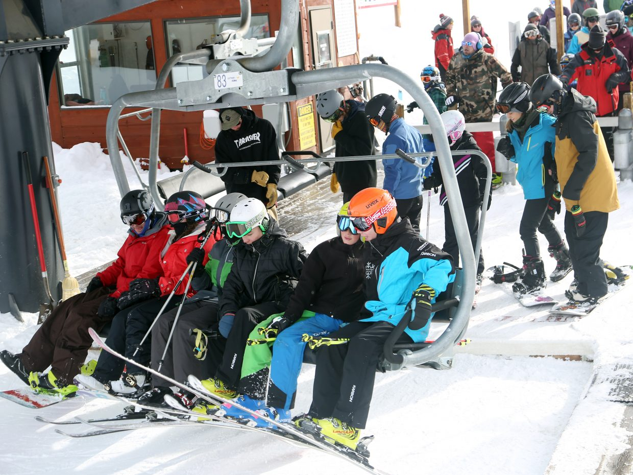 Passengers get on the Christie Peak Express chairlift on Thursday at the Steamboat Ski Area. With the holiday rush in full swing, lines can be extra long all over the mountain.