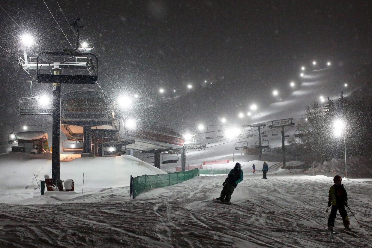 With the snow falling, skiers and snowboarders take to the mountain Christmas evening under the lights. Night skiing will continue through Friday. Adult lift tickets cost $37, and prices are less for teens and children. Two more time frames are scheduled for night skiing, the first from Jan. 7 to Feb. 19, and the second from Feb. 20 to Mar. 28. Those days will be from Thursday through Monday only.