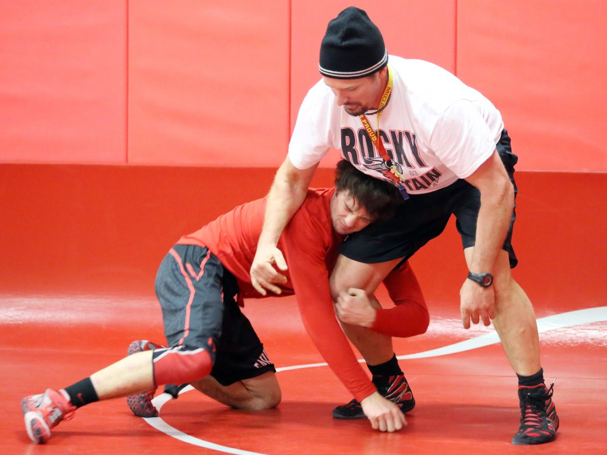 Steamboat Springs High School wrestling coach Travis Bryant, right, works on drills with junior Matthew Hansen on Wednesday. Hansen is the Sailors' lone undefeated wrestler heading into the back half of the season.