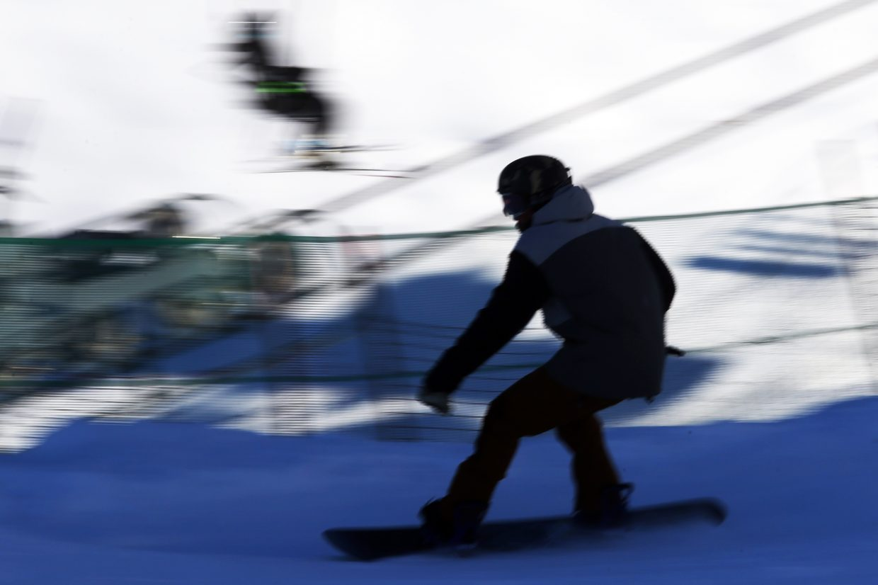 The silhouette of a snowboarder descends to the base of Lil' Rodeo on Friday at the Steamboat Ski Area. Steamboat Today reporter and photographer Austin Colbert, a rookie snowboarder, has yet to tackle any of the terrain parks.