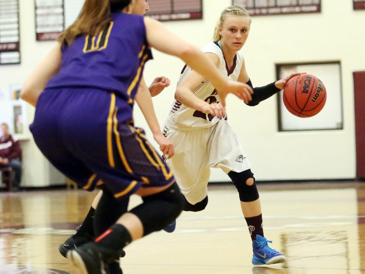 Soroco's Morgan George, right, dribbles around a West Grand defender on Saturday in Oak Creek.